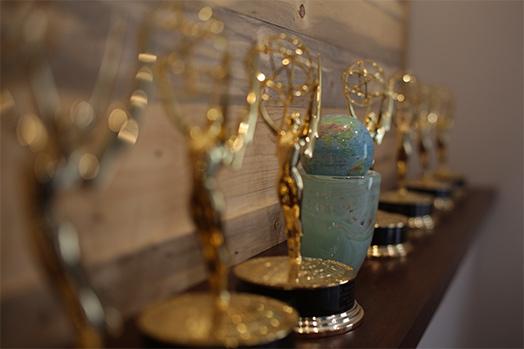 Shelf of numerous awards